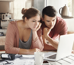 Pros and Cons of a Larger Down Payment Couple Image