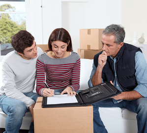 Income Property 101: Steps to Becoming a Landlord Couple Moving Image