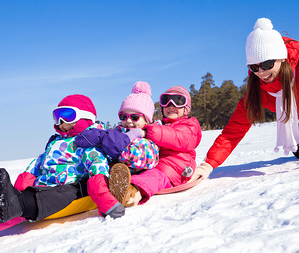Winter Activities to Enjoy with Your Family Sledding Image